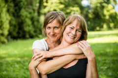 Senior mother with child portrait. Outdoor portrait of smiling happy senior mother with her adult daughter Stock Photography