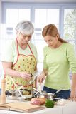 Senior mother and daughter cooking together Stock Photos