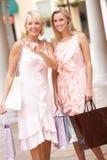 Senior Mother And Daughter Enjoying Shopping Stock Photo
