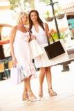Senior Mother And Daughter Enjoying Shopping Trip Royalty Free Stock Photography