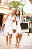 Senior Mother And Daughter Enjoying Shopping Trip Royalty Free Stock Images