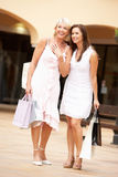 Senior Mother And Daughter Enjoying Shopping Trip Stock Images