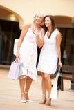Senior Mother And Daughter Enjoying Shopping Trip Stock Images