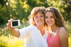 Senior mother with daughter selfie Royalty Free Stock Image