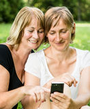 Senior mother and daughter with smartphone Royalty Free Stock Photo