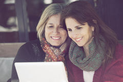 Senior mother and daugther with digital tablet Stock Image