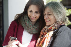 Senior mother and daugther with phone Stock Photo