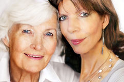 Senior mother and mature daughter Stock Photos