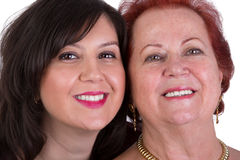 Senior Mother and Middle Age Daughter Cheek to Cheek Royalty Free Stock Image