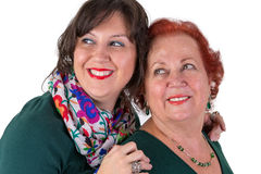 Senior Mother and Middle Age Daughter next to Each Other Looking Royalty Free Stock Images