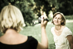 Senior mother is taking video of her child Royalty Free Stock Image