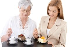 Senior mother and young daughter at cafe Stock Image