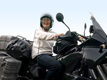 Senior on a motorbike Royalty Free Stock Photo
