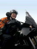 Senior on a motorbike royalty free stock photos