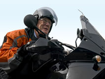 Senior on a motorbike Stock Photo