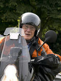 Senior on a motorbike Royalty Free Stock Photo