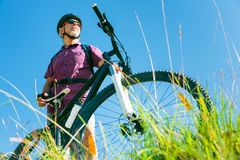 Senior With Mountain Bike Standing At Top Of A Hill Stock Photography