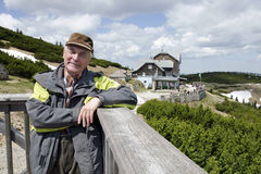 The senior by mountain shelter Ottohaus, Alps Royalty Free Stock Photography