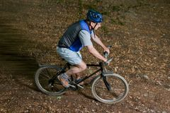 Senior on a mountainbike Stock Photography
