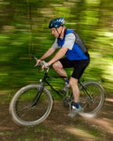 Senior mountainbiking. Senior cycling on a mountainbike Royalty Free Stock Image