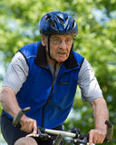 Senior mountainbiking. Senior cycling on a mountainbike Royalty Free Stock Images