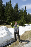 The senior in the mountains with spring snow Stock Photo