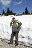 The senior in the mountains with spring snow Royalty Free Stock Photography