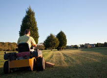 Senior mowing lawn Royalty Free Stock Photo