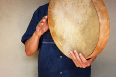 Senior musician playing ethnic drum. Stock Images
