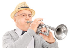 Senior musician playing a trumpet Royalty Free Stock Photography