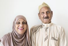 Senior Muslim couple in traditional dress at home royalty free stock photo