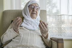 A senior woman praying stock photo