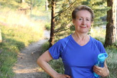 Senior Natural Woman Relaxing After Exercise Stock Photos