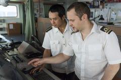 Maritime Training. Senior Navigation Officer Training a Junior Officer Royalty Free Stock Photo