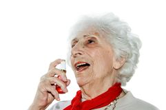 Senior with nitro. Senior taking nitroglycerin spray for heart pains Stock Photo