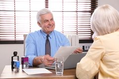 Senior notary working with client