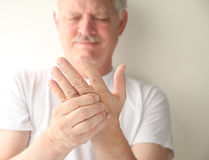 Senior with numb hand Stock Image