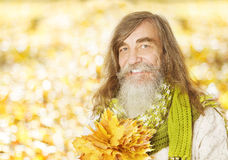 Senior old man portrait, autumn maple leaves, citi Stock Photos