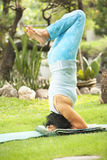 Senior old woman doing yoga in park Royalty Free Stock Photography