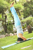 Senior old woman doing yoga in park Stock Photography