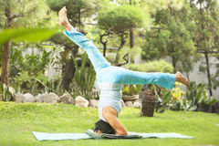 Senior old woman doing yoga in park Royalty Free Stock Images