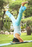 Senior old woman doing yoga in park Stock Images