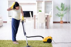 The senior old woman tired after vacuum cleaning house. Senior old woman tired after vacuum cleaning house Stock Photos