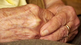 Senior old woman young man hold hand wrinkle skin close up Stock Photo