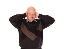 Senior older man covering ears Royalty Free Stock Images