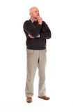 Senior older man standing and thinking Stock Image