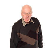 Senior older man sticking out tongue Stock Photos
