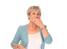 Senior older woman covering mouth Stock Photography