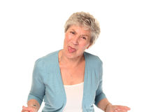 Senior older woman sticking out tongue Royalty Free Stock Photography
