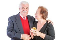 Senior with one arm around his lady friend Stock Photos